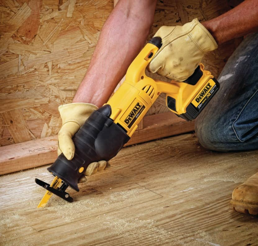 Technician with Dewalt DCS380P1