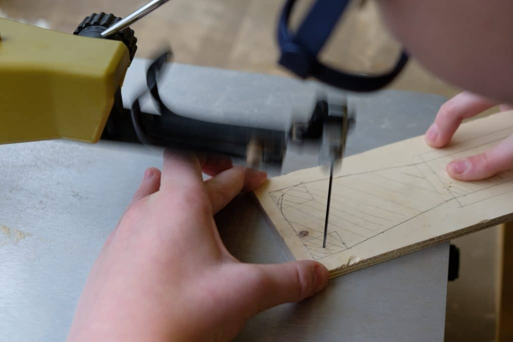 Sawing with a scroll saw
