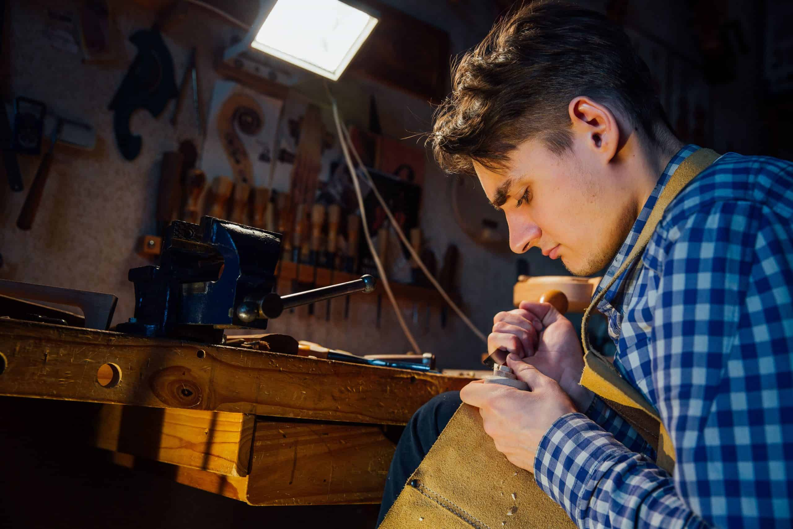 young man woodworking